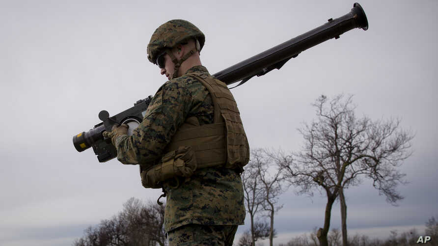 A US Marine carries a Stinger air defense missile launcher during training at the Capu Midia Surface to Air Firing Range, on…