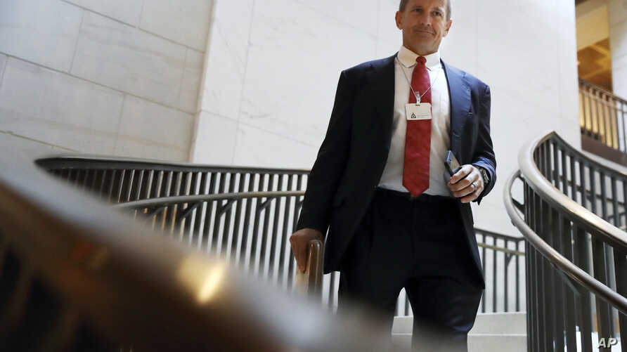 FILE - In this Nov. 30, 2017 file photo, Blackwater founder Erik Prince arrives for a closed meeting with members of the House…