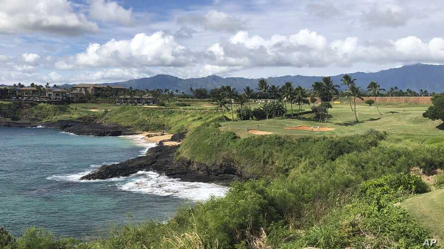 In this Nov. 15, 2018 photo, the 14th hole at the Hokuala Ocean Course in Lihue, Hawaii cuts across the Pacific Ocean on the…