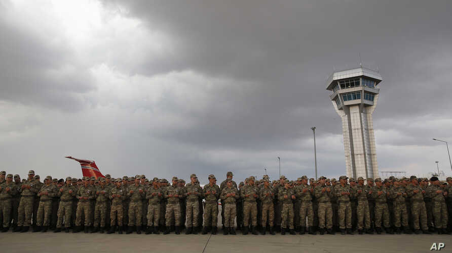 Turkish soldiers stand during a ceremony for soldier Sefa Findik, killed in action with Kurdish fighters in Syria earlier…