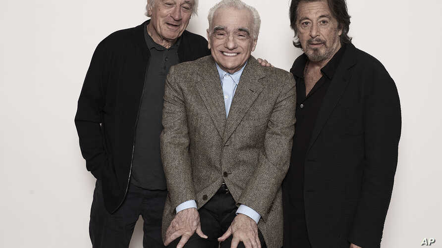 This Sept. 30, 2019 photo shows actor Al Pacino, from right, director Martin Scorsese, and actor Robert De Niro posing for a…