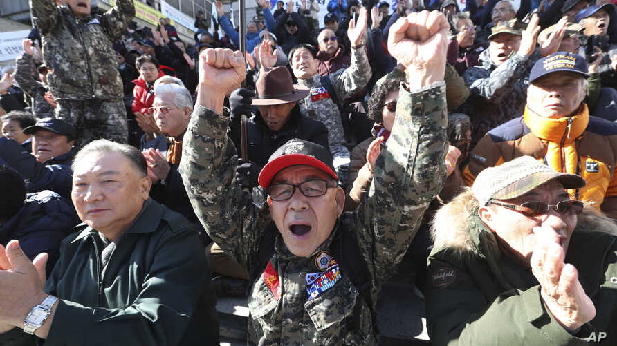 A South Korean Vietnam War veteran shouts during a rally to denounce the United States' demand for raising the defense costs…