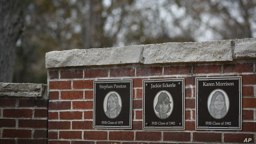FILE - The faces of the three Finneytown students killed in a stampede at The Who's Dec. 3, 1979 concert, are displayed as part of a memorial at the Finneytown High School secondary campus in Finneytown, Ohio, Nov. 21, 2019.