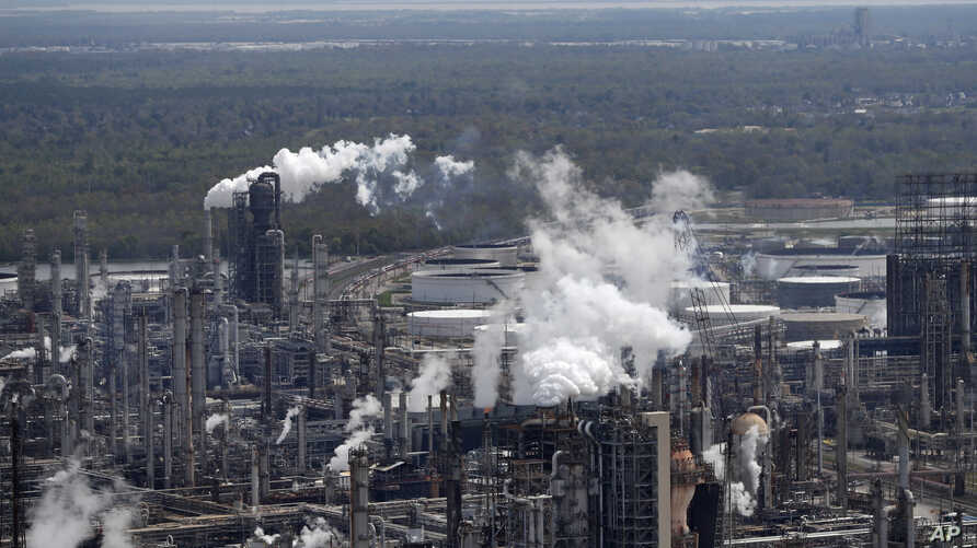 FILE - In this March 8, 2018, file photo wetlands are seen beyond the Shell Norco refinery in Norco, La. The world may be…