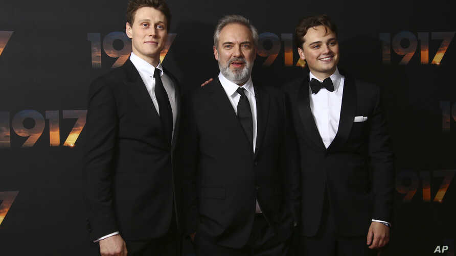 Actor George MacKay, from left, director Sam Mendes and actor Dean-Charles Chapman pose for photographers upon arrival at the…