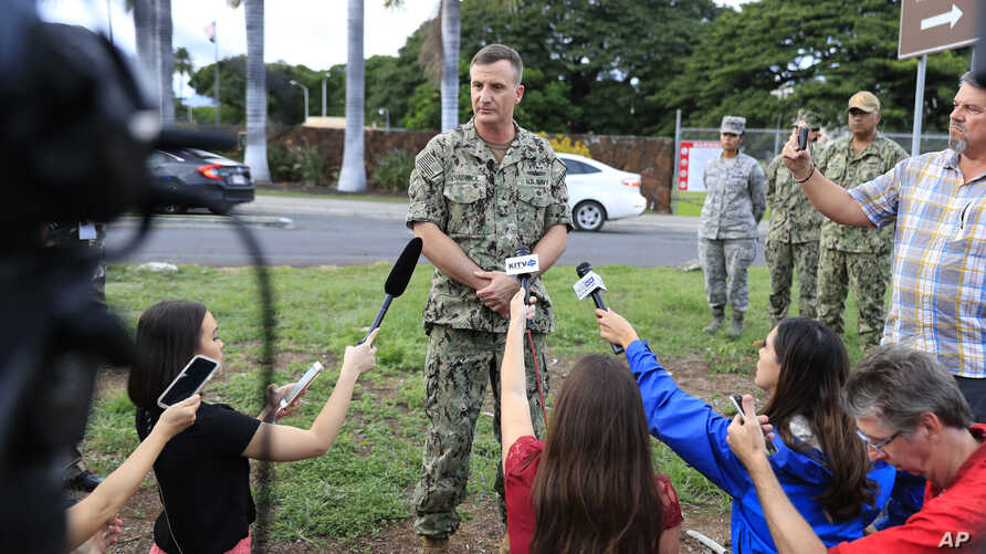 U.S. Navy Rear Adm. Robb Chadwick speaks to the media at the main gate at Joint Base Pearl Harbor-Hickam, Dec. 4, 2019, in Hawaii, following a shooting.