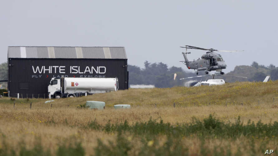 A Navy helicopter hovers at Whakatane Airport, as the recovery operation to return the victims of the Dec. 9 volcano eruption continues off the coast of Whakatane New Zealand, Dec. 13, 2019.