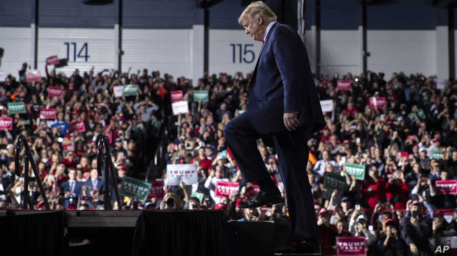 FILE - President Donald Trump arrives at W.K. Kellogg Airport to attend a campaign rally in Battle Creek, Mich., , Dec. 18, 2019.
