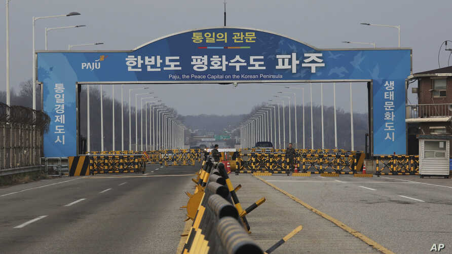 South Korean army soldiers stand guard at the Unification Bridge, which leads to the Panmunjom in the Demilitarized Zone in Paju, South Korea, Dec. 16, 2019.