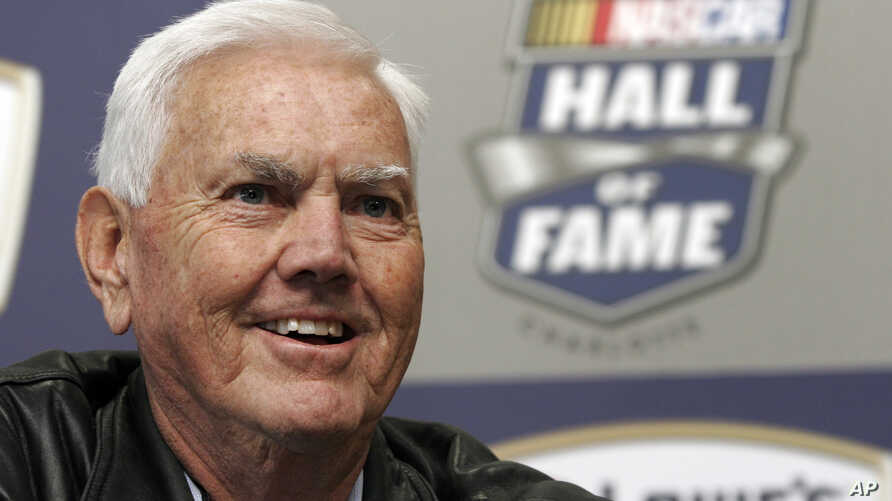 Former NASCAR driver and owner Junior Johnson smiles as he speaks to media about being named to the NASCAR Hall of Fame during a news conference at Lowe's Motor Speedway in Concord, N.C., Oct. 16, 2009.