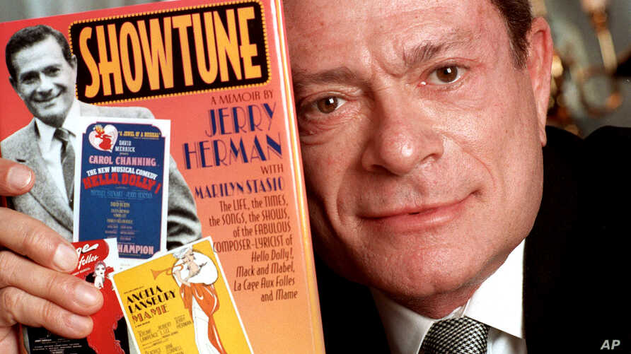 """FILE - In this Nov. 19, 1996, file photo, composer Jerry Herman displays his book """"Showtune,"""" in New York."""