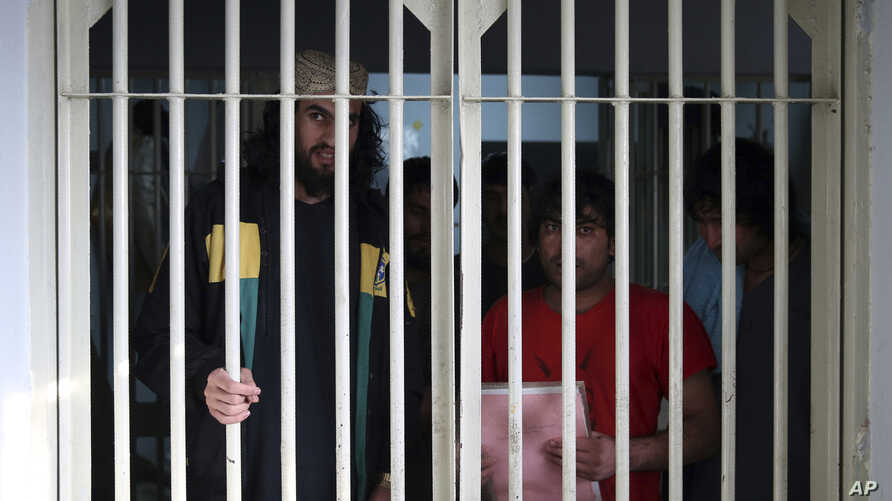 In this Saturday, Dec. 14, 2019, photo, jailed Taliban are seen inside the Pul-e-Charkhi jail in Kabul, Afghanistan.  Thousands…