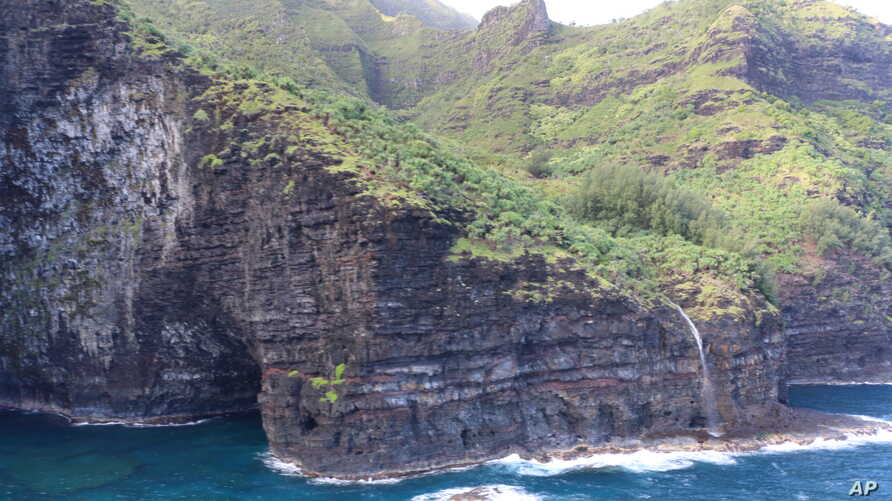 This photo provided by the Hawaii department of Land and Natural Resources shows an area over Na Pali Coast State Wilderness Park, where search-and-rescue personnel were looking for a tour helicopter that disappeared in Hawaii, Dec. 27, 2019.
