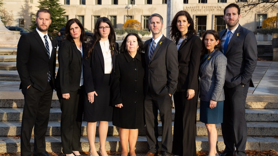 The seven children and wife of Robert Levinson, an American missing in Iran since 2007, appear outside a U.S. District Court in