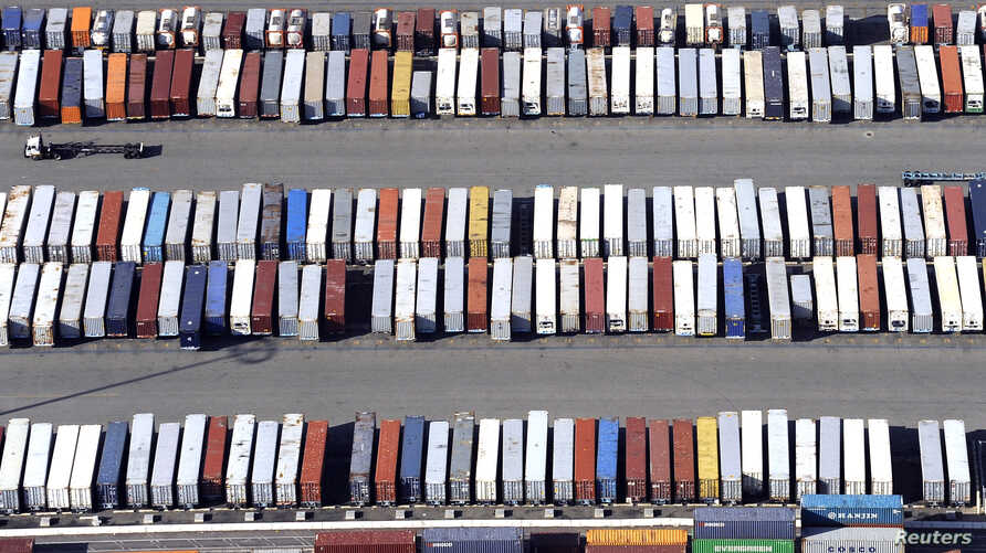 Containers are seen stacked up at the ports of Los Angeles and Long Beach, California February 6, 2015 in this aerial image…