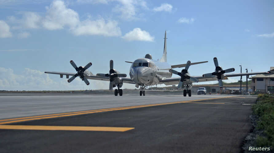 A Japan Maritime Self-Defense Force P-3C Orion arrives on Marine Corps Base Hawaii for Rim of the Pacific (RIMPAC) military…
