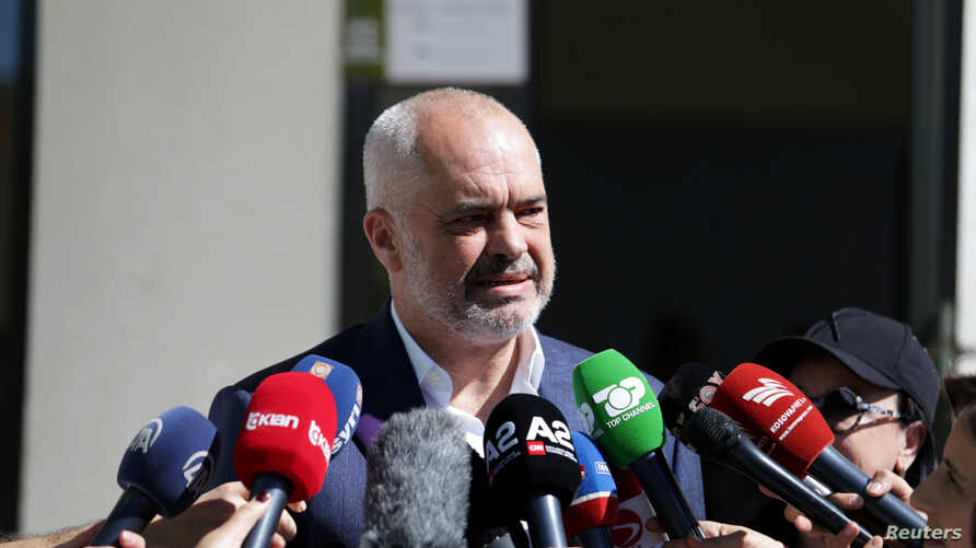 Albania's Prime Minister Edi Rama speaks to the media as he arrives at the polling station near Tirana, Albania June 30, 2019…