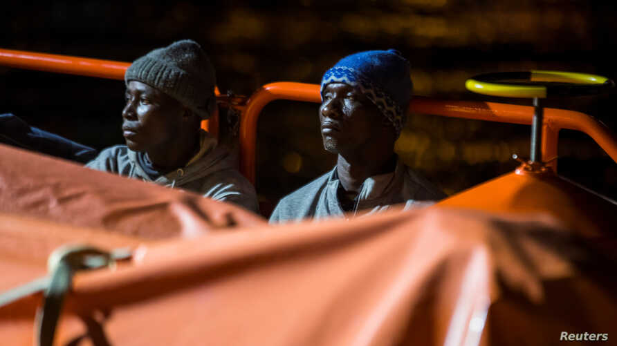 Migrants intercepted off the coast of Gran Canaria arrive aboard a Spanish maritime rescue boat at the port of Arguineguin on…