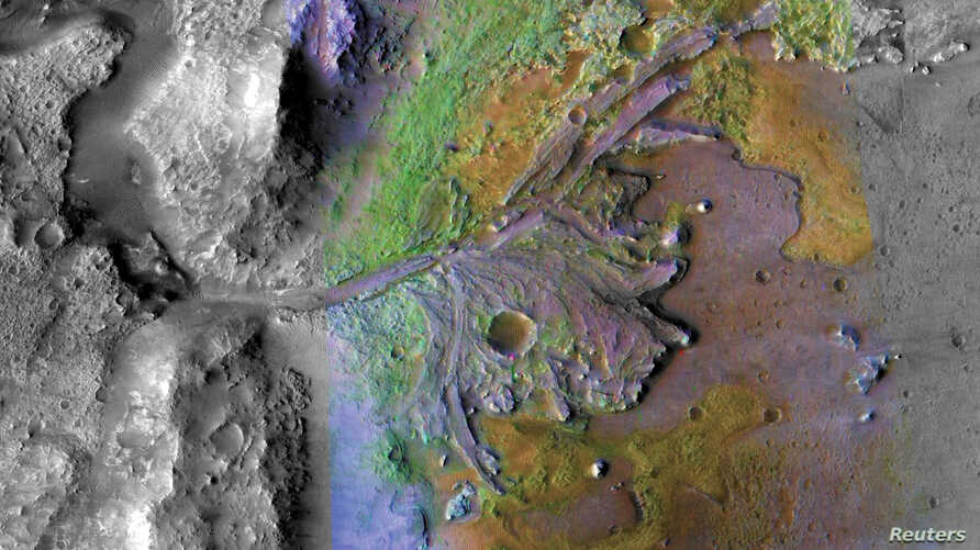 FILE - Fans and deltas formed by water and sediment are seen in the Jezero Crater on Mars, identified as a potential landing site for the Mars 2020 Rover, in this false color image taken by NASA's Mars Reconnaissance Orbiter, published May 15, 2019.