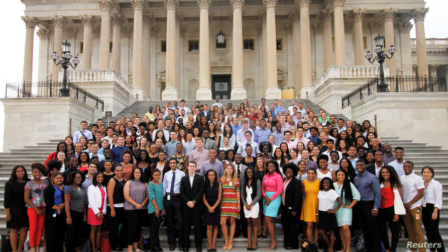 A group of Democrat Capitol Hill interns pose on the east steps of the U.S. Capitol in Washington, D.C July 19, 2016 and…