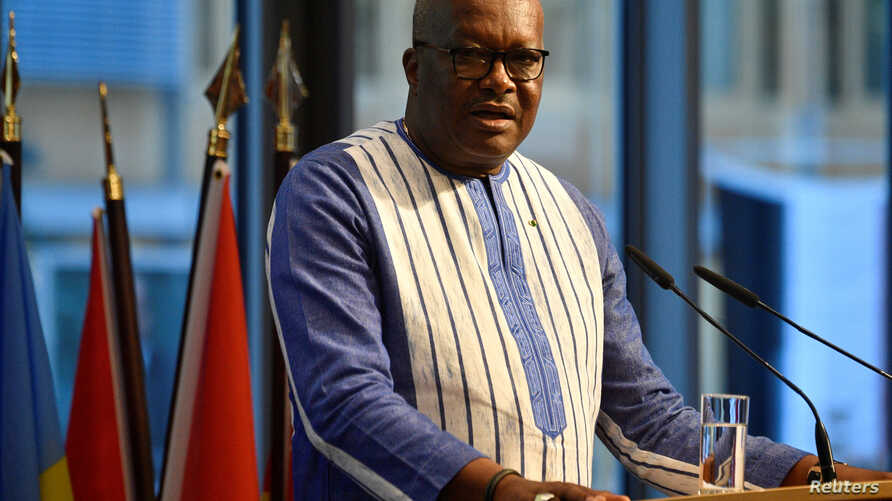 """FILE - Burkina Faso's President Roch Marc Christian Kabore addresses participants of the """"G20 Investment Summit - German Business and the CwA Countries 2019"""" on the sidelines of a Compact with Africa (CwA) in Berlin, Germany, Nov. 19, 2019."""