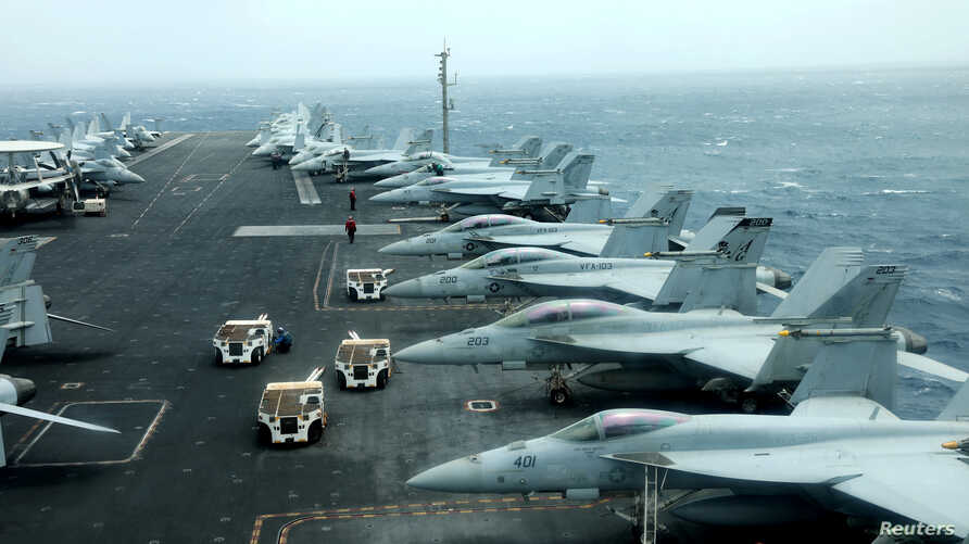 FILE - F/A-18F aircrafts are seen on the deck of USS Abraham Lincoln in the Gulf of Oman near the Strait of Hormuz, July 15, 2019.