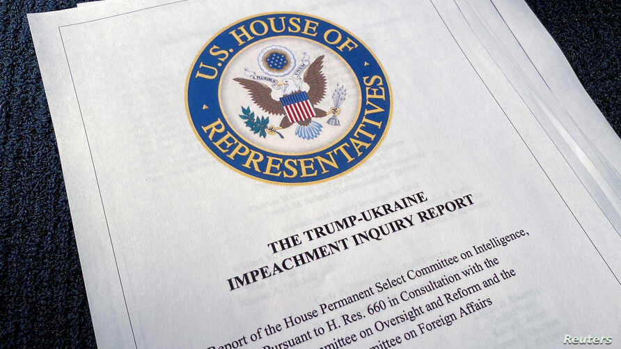 The 300 page Trump-Ukraine Impeachment Inquiry Report is seen after being released by the U.S. House Intelligence Committee in…