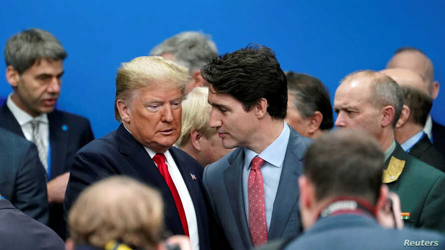 U.S. President Donald Trump talks with Canada's Prime Minister Justin Trudeau during a North Atlantic Treaty Organization…