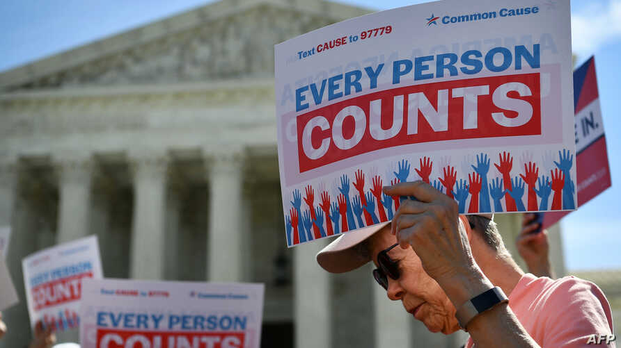 FILE - Demonstrators rally at the U.S. Supreme Court in Washington, April 23, 2019, to protest a proposal to add a citizenship question in the 2020 Census.