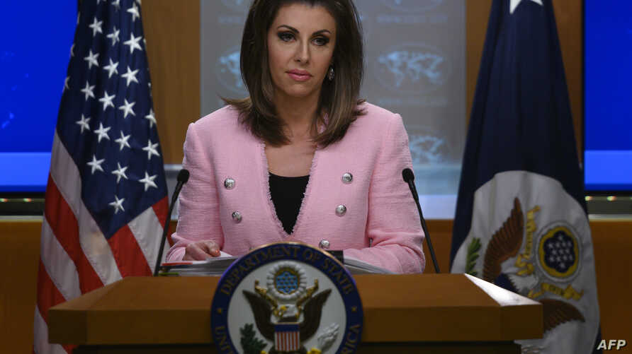 FILE - U.S. State Department spokeswoman Morgan Ortagus stands at the lectern during a press conference at the State Department, in Washington, June 10, 2019.