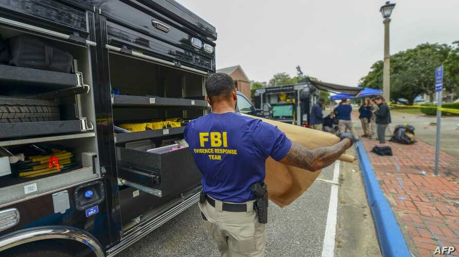 This handout photo released Dec. 7, 2019, by the Federal Bureau of Investigation (FBI) shows a member of an FBI Evidence Response Team after a shooting incident at Pensacola Naval Base, in Florida, Dec. 6, 2019.