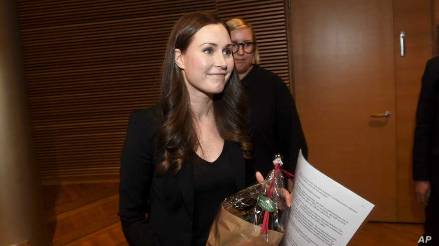 The candidate for the next Prime Minister of Finland, Sanna Marin, smiles after she won the SDP's Prime Minister candidate vote against Antti Lindtman, in Helsinki, Finland, Dec. 8, 2019.