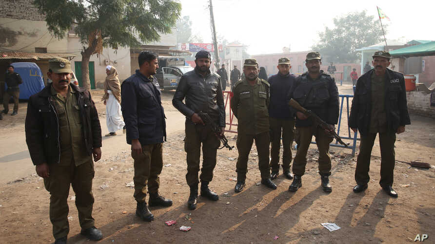 Pakistani police officers stand guard outside Multan jail after a court  convicted Muslim professor Junaid Hafeez of blasphemy, sentencing him to death, in Multan, Pakistan, Dec. 21, 2019.