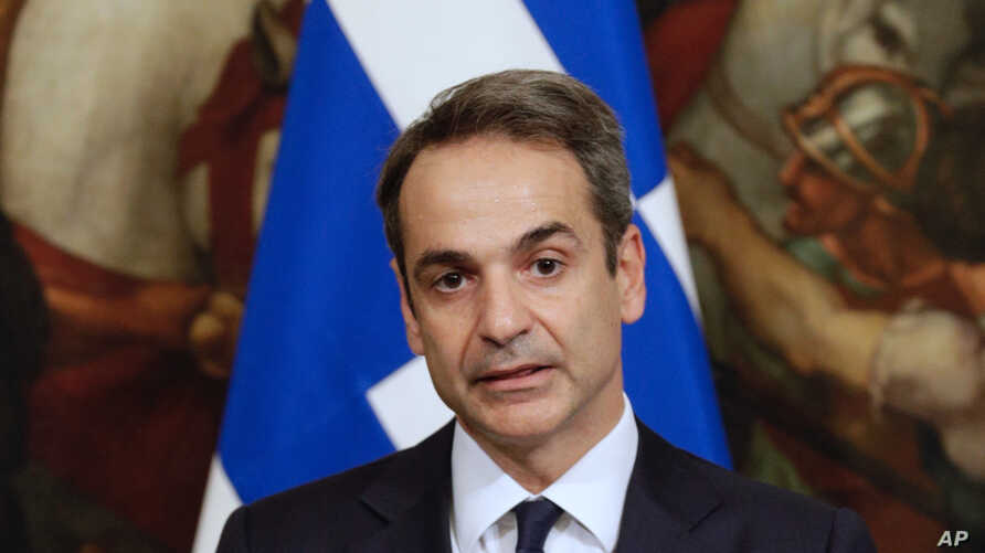 Greek Premier Kyriakos Mitsotakis attends a joint press conference with Italian Premier Giuseppe Conte, at Chigi Palace government's office, in Rome, Nov. 26, 2019.