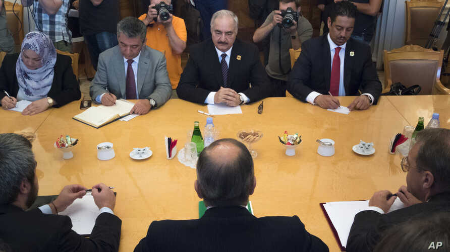 FILE - Libyan militia commander General Khalifa Haftar, top center, listens to Russian Foreign Minister Sergey Lavrov, bottom center, during their meeting in Moscow, Russia, Aug. 14, 2017.