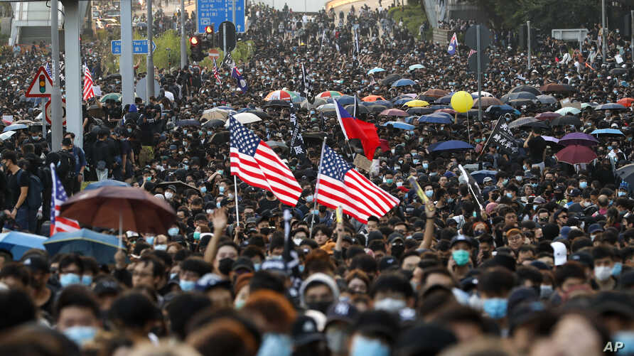 Pro-democracy protesters flood a street during a rally in Hong Kong, Dec. 1, 2019.