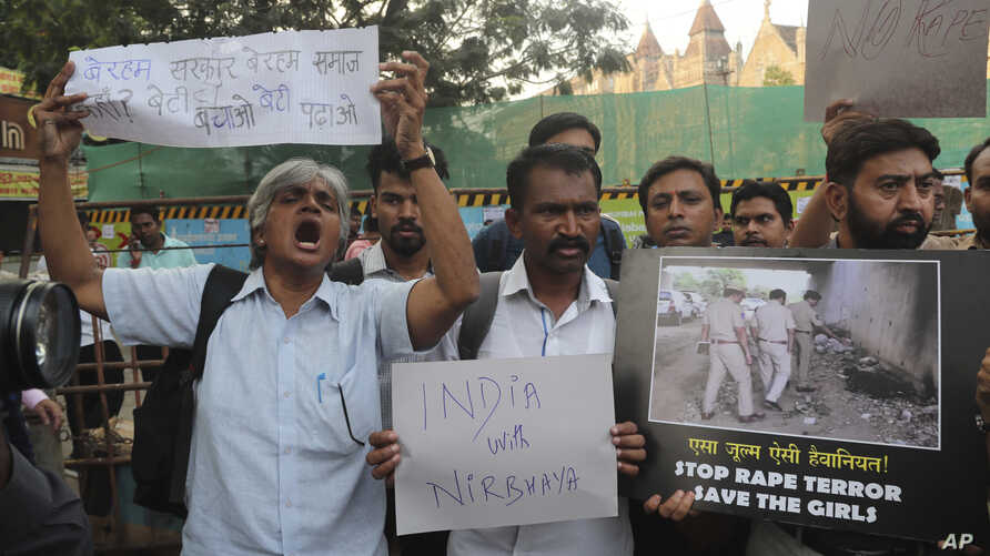 Activists shout slogans demanding justice in the case of a veterinarian who was gang-raped and killed last week, during a protest in Mumbai, India, Dec. 2, 2019.