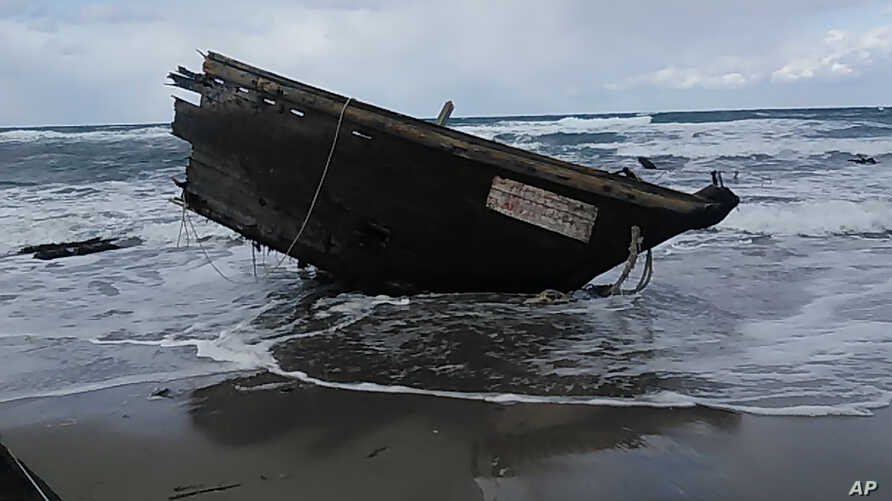 This photo provided by Sado Coast Guard Station shows a part of a boat on Sado Island, Niigata Prefecture, northern Japan, Dec. 28, 2019.
