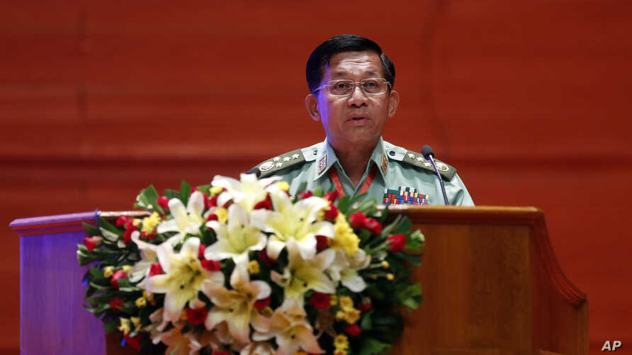 FILE - Myanmar's Army Commander Senior Gen. Min Aung Hlaing speaks during a ceremony at the Myanmar International Convention Center in Naypyitaw, Myanmar, Oct. 28, 2019.