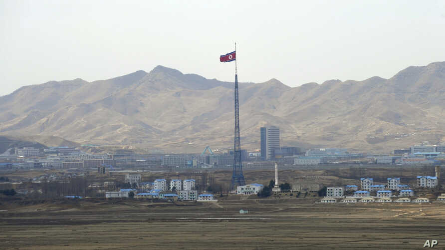 FILE - North Korea's flag flies on a tower high above the village of Ki Jong Dong, as seen from an observation post in Panmunjom, March 25, 2012.