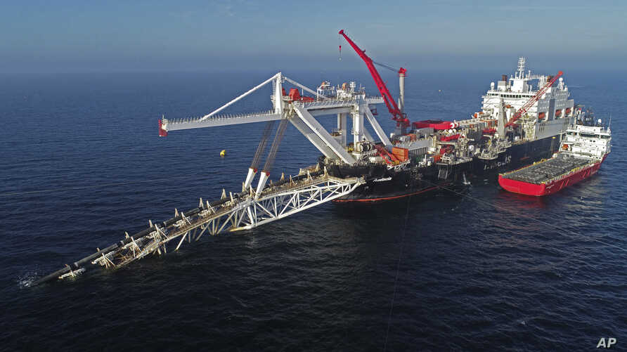 FILE - A ship works offshore in the Baltic Sea laying parts of the natural gas pipeline Nord Stream 2, extending from Russia to Germany, Nov. 11, 2018.