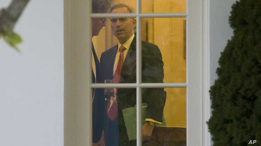 FILE - White House Counsel Pat Cipollone is seen during a meeting with President Donald Trump in the Oval Office of the White House, in Washington, Nov. 14, 2019.