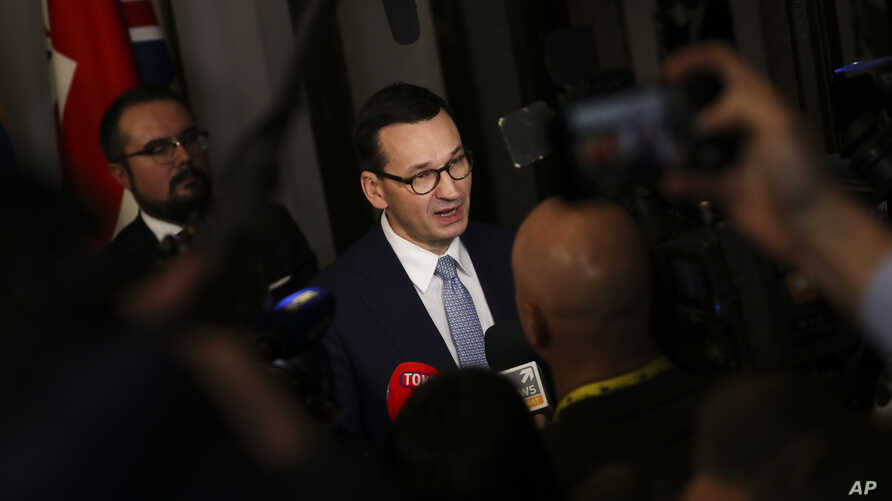 FILE - Polish Prime Minister Mateusz Morawiecki speaks with the media at the end of an EU summit in Brussels, Belgium, Dec. 13, 2019.