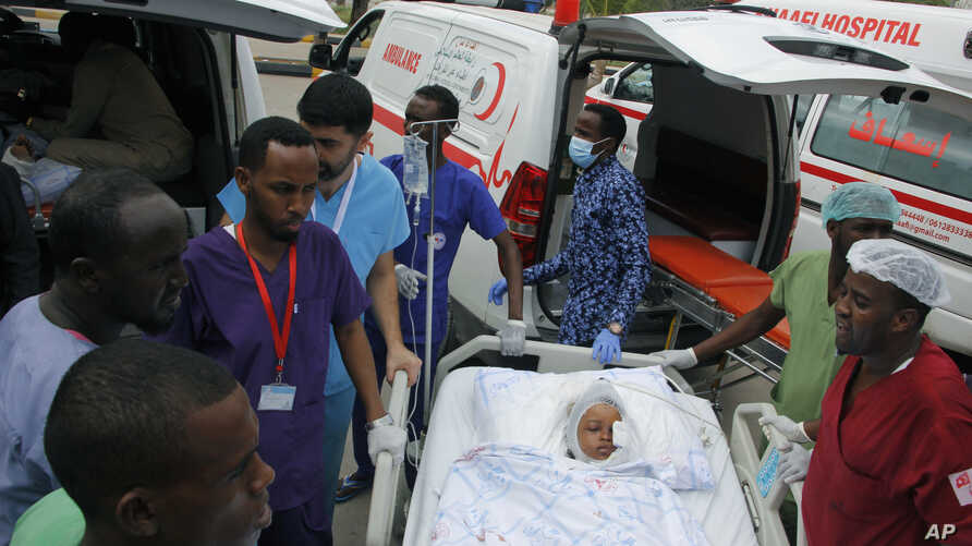 Medical personnel attend to a wounded child to be airlifted to the Turkish capital Ankara for treatment after Saturday's car bomb blast in Mogadishu, Somalia, Dec. 29, 2019.