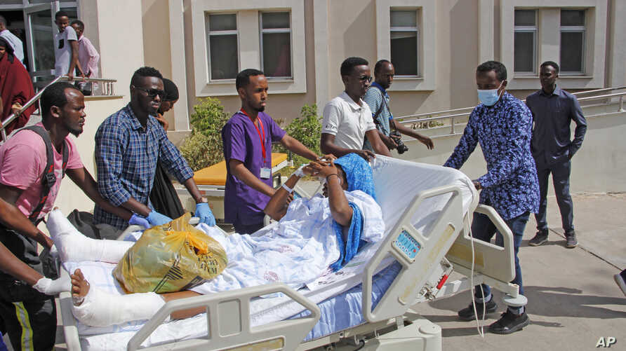 Medical personnel carry a wounded person to be airlifted to the Turkish capital for treatment after they were injured in…
