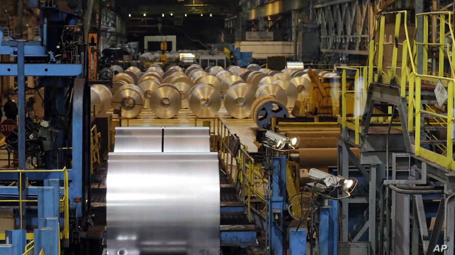 FILE - Finished galvanized steel coils are seen in the hot dip galvanizing line at ArcelorMittal Steel in Cuyahoga Heights, Ohio, Feb. 15, 2013. Brazil and Argentina are among the countries from which the U.S imports its metals.
