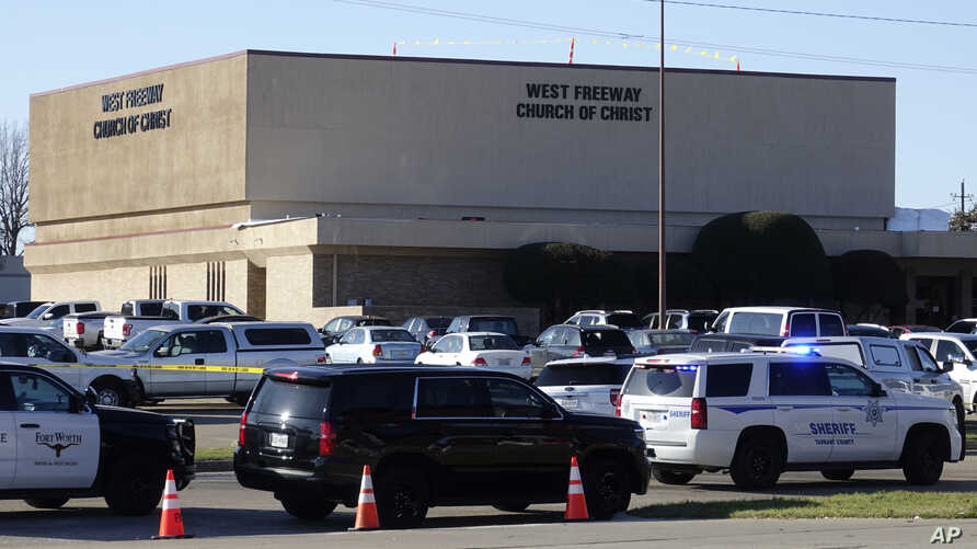 Law enforcement vehicles are seen outside West Freeway Church of Christ, as authorities continue to investigate a fatal shooting at the church, in White Settlement, Texas, Dec. 29, 2019.