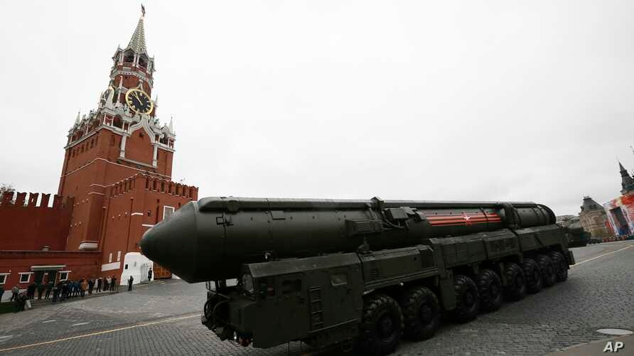 FILE - A nuclear-capable Russian Topol M intercontinental ballistic missile with launch vehicle rolls along Red Square during a military parade, in Moscow, Russia, May 9, 2017.