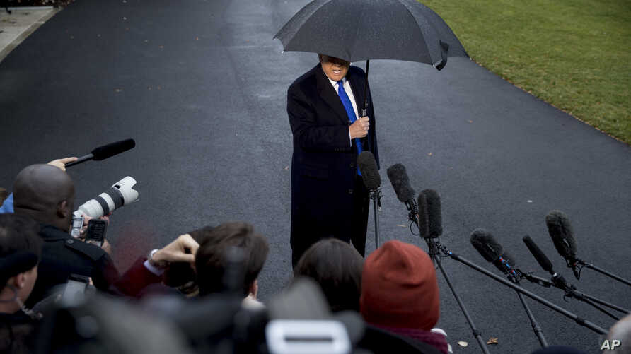 President Donald Trump speaks to members of the media before boarding Marine One on the South Lawn of the White House in Washington, Dec. 2, 2019.