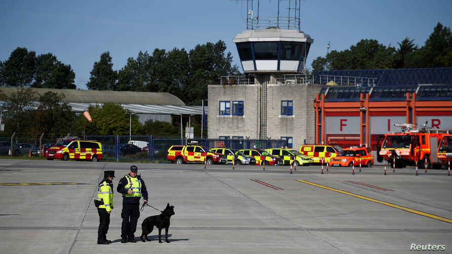 FILE - Officers from Ireland's Garda (Police) are seen at Dublin International Airport, Ireland, Aug. 25, 2018.